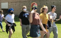 A group of Arts Academy students break the mold and arrive to the send-off on foot.