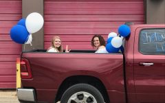 Two grads share a ride in the cargo.