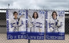 Salem Boys Varsity Hockey displays banners along the route.