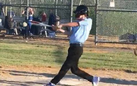 Michigan Blue Jays player and Pioneer student Lucas Galante swings his bat to make contact with the oncoming pitch.